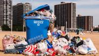 recycling bin overflowing with plastic