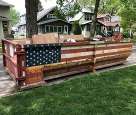 dumpster painted with American flag